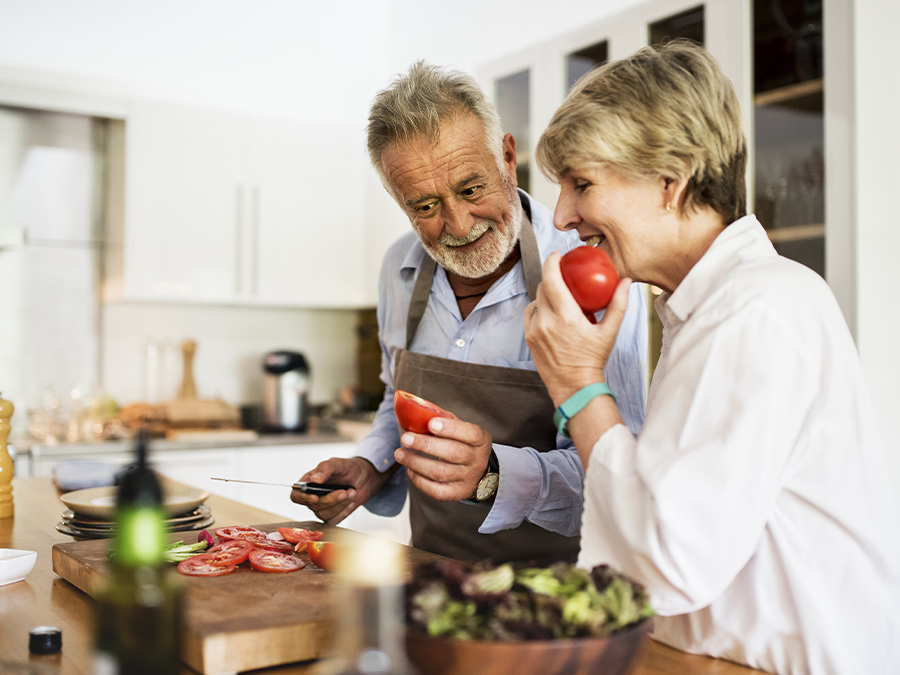 Cardiac patient cooks a meal with his wife.